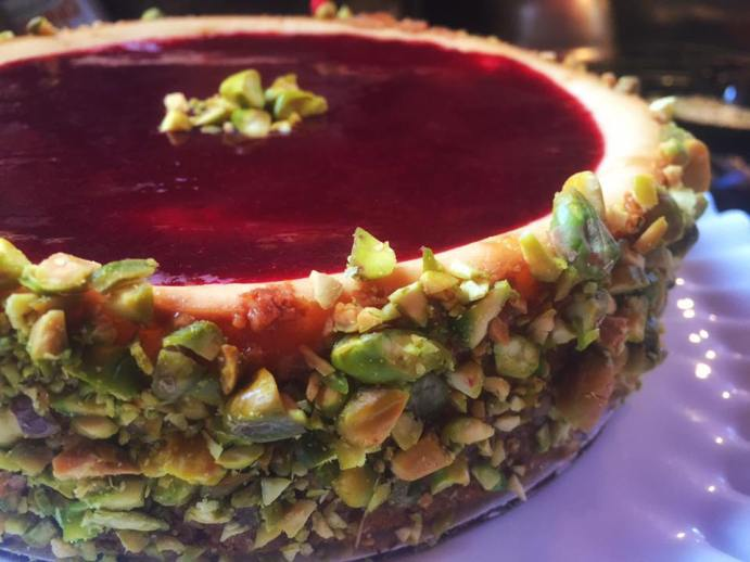 NY style cheesecake with a raspberry coulee and pistachio crust